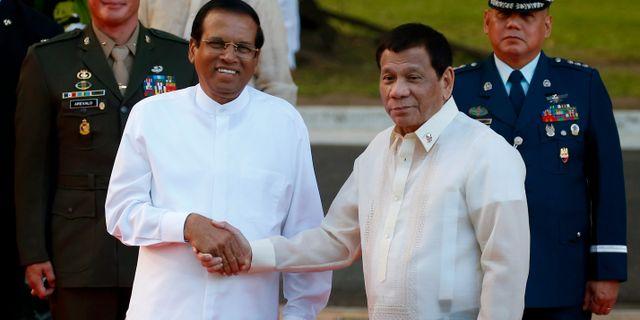Maithripala Sirisena och president Rodrigo Duterte.  Bullit Marquez / TT NYHETSBYRÅN
