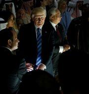 Donald Trump tillsammans med andra ledare i ett center som arbetar mot extremism i Riyadh. JONATHAN ERNST / TT NYHETSBYRÅN