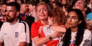Engelska fans i tårar efter förlusten mot Kroatien. Hyde Park, London. Matt Dunham / TT NYHETSBYRÅN