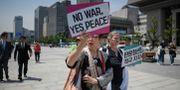 Fredsprotester i Seoul. ED JONES / AFP
