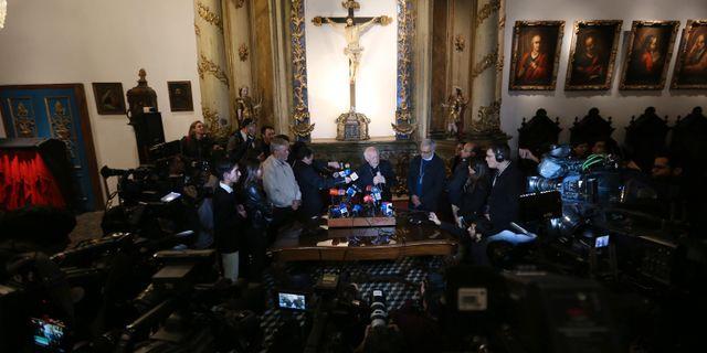 En presskonferens i katolska kyrkani Santiago tidigare i maj. CLAUDIO REYES / AFP