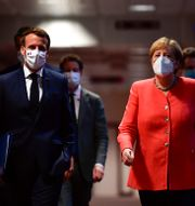 Frankrikes president Emmanuel Macron och Tysklands förbundskansler Angela Merkel. John Thys / TT NYHETSBYRÅN
