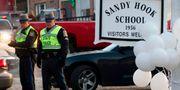Poliser vid Sandy Hook-skolan i Newtown, Connecticut 2012. DON EMMERT / AFP