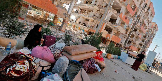 En kvinna med sina ATTA KENARE / AFP