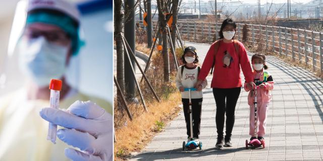 En kvinna och två barn i Sydkorea. TT
