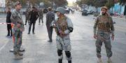 Säkerhetsvakter i Kabul på valdagen. OMAR SOBHANI / TT NYHETSBYRÅN