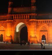 Öde vid den ikoniska porten i Mumbai, Indien. Där brukar vara fullt vid tolvslaget på nyårsafton. Rafiq Maqbool / TT NYHETSBYRÅN