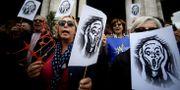 Demonstranter i Rom på lördagen. FILIPPO MONTEFORTE / AFP