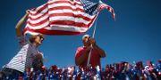 Amerikaner med USA:s flagga. Jake Danna Stevens / TT NYHETSBYRÅN/ NTB Scanpix