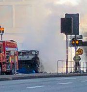 Bussen när den brann. Tomas Bengtsson/TT / TT NYHETSBYRÅN