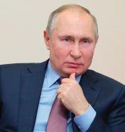 Musk och Putin. TT