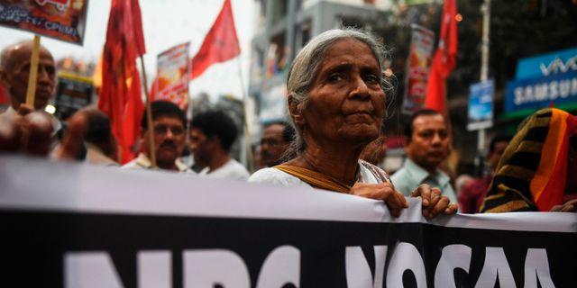 Protester i Indien.  DIBYANGSHU SARKAR / TT NYHETSBYRÅN