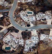 Arkivbild: En flygbild visar ett utbränt kvarter efter att Camp Fire dragit fram, november 2018. Noah Berger / TT NYHETSBYRÅN