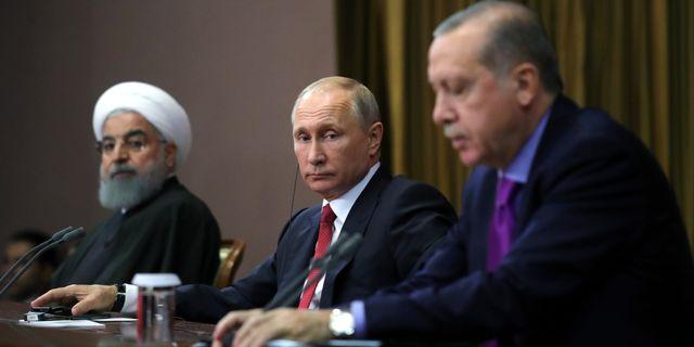 Irans president Hassan Rouhani, Rysslands president Vladimir Putin och Turkiets president Recep Tayyip Erdogan. Mikhail Klimentyev / TT / NTB Scanpix