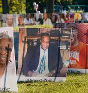 Plakat med porträtt av personer som dött i Detroit. Carlos Osorio / TT NYHETSBYRÅN
