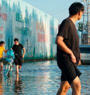 Illustrationsbild: Översvämning i kinesiska Xinxiang i Henanprovinsen tidigare i juli.  Dake Kang / TT NYHETSBYRÅN