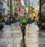 Arkivbild: Ett cykelbud i centrala Cardiff Ben Birchall / TT NYHETSBYRÅN