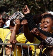 Zuma-supportrar efter att den tidigare presidenten åtalats i april 2019/Arkivbilder Themba Hadebe / TT NYHETSBYRÅN