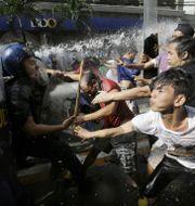 Demonstranter i Filippinernas huvudstad Manila inför Donald Trumps ankomst.  TT
