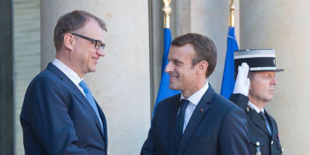 Juha Sipilä och Emmanuel Macron. Michel Euler / TT / NTB Scanpix