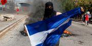 Protester i Tegulcigapa i Honduras på söndagen Fernando Antonio / TT NYHETSBYRÅN