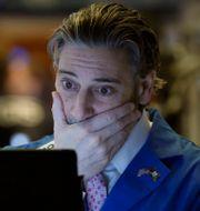 Tradern John Romolo på New York Stock Exchange i mars förra året. Richard Drew / TT NYHETSBYRÅN