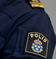 En polis. Arkivbild.  Janerik Henriksson/TT / TT NYHETSBYRÅN