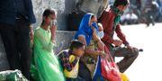 Familj i Indien.  Manish Swarup / TT NYHETSBYRÅN