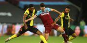 West Ham Uniteds Declan Rice (mitten) och Watfords Andre Gray (t.h.) och Nathaniel Chalobah (t.v.) under en Premier League-match.  Richard Heathcote / TT NYHETSBYRÅN