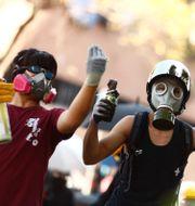 Protester mot säkerhetslagen i Hongkong.  THOMAS PETER / TT NYHETSBYRÅN