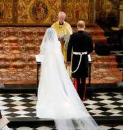 Ärkebiskopen viger prins Harry och Meghan i kapellet vid Windsor Castle, 19 maj 2018.  Owen Humphreys / TT NYHETSBYRÅN