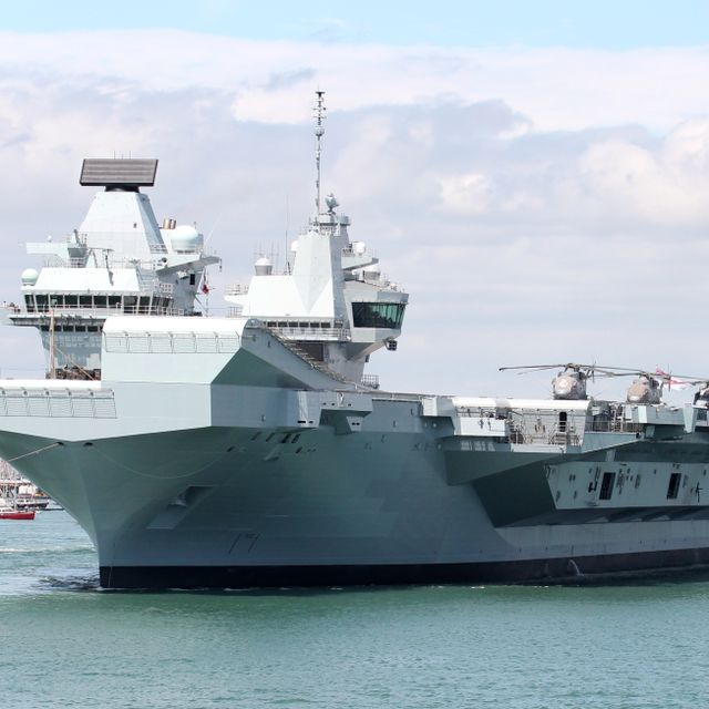 PORTSMOUTH, UK – 17TH JUN 2019: The Royal Navy aircraft carrier HMS QUEEN ELIZABETH leaving the Naval Base for five weeks of trials prior to its summer deployment to the United States Shutterstock
