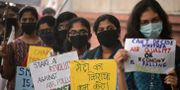 Människor protesterar mot den dåliga luften i Delh SAJJAD HUSSAIN / AFP