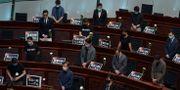 Parlamentsledamöter på torsdagen hedrade minnet av massakern på Himmelska fridens torg den 4 juni 1989. Vincent Yu / TT NYHETSBYRÅN