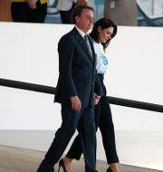 Jair Bolsonaro med frun Michelle Bolsonaro. Arkivbild. Eraldo Peres / TT NYHETSBYRÅN