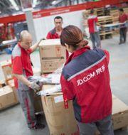 JD.com staff receiving incoming goods. Shutterstock