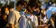 Minnesvaka för en aktivist som föll och dog under en demonstration. PHILIP FONG / AFP
