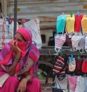 Trump-volontärer/Cristo Redantor i Rio de Janeiro/Försäljning av ansiktsmasker i Indien AP/TT