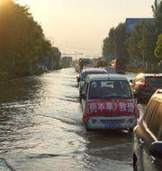 Arkivbild. Bilden är från en översvämning i Kina tidigare i år. Dake Kang / TT NYHETSBYRÅN