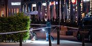 Polisens kriminaltekniker arbetar innanför avspärrningarna vid Triangeln efter skjutningen Johan Nilsson/TT / TT NYHETSBYRÅN