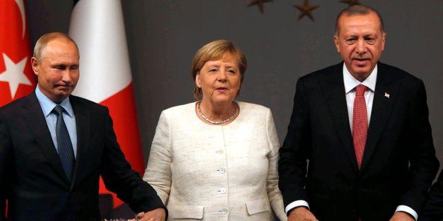Putin, Merkel och Erdogan Lefteris Pitarakis / TT NYHETSBYRÅN
