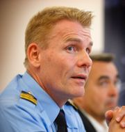 Polisens förundersökningsledare Jan Staaf/Gatan där dubbelmordet skedde. TT