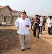 Bild på Kim Jong-Un som släpptes den 23 juli. TT NYHETSBYRÅN