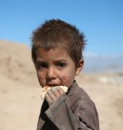 Ett barn i Kabul, Afghanistan.  Rahmat Gul / TT NYHETSBYRÅN