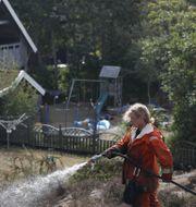 Eftersläckningsarbete dagen efter branden på Björkö, i Göteborgs skärgård. Anders Ylander/TT / TT NYHETSBYRÅN