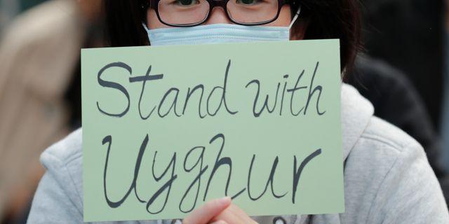 Demonstration till stöd för Kinas uigurer. Lee Jin-man / TT NYHETSBYRÅN
