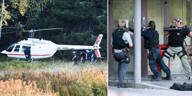 Poliser vid insatsen i Västberga. TT.