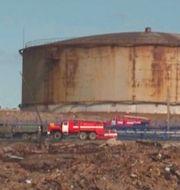 Den skadade reservoaren i Ryssland t.h. TT