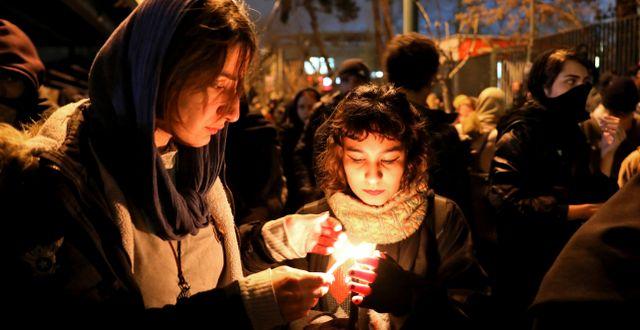 Minnesstund i Teheran för dödsoffren. Bild från den 11 januari. Ebrahim Noroozi / TT NYHETSBYRÅN