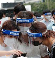 Många av fallen kan spåras till en protest mot regeringens coronahantering. Bild från 7 augusti. Ahn Young-joon / TT NYHETSBYRÅN